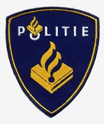 Het politie logo met de Illuminati-vlam, het vuur van Prometheus.